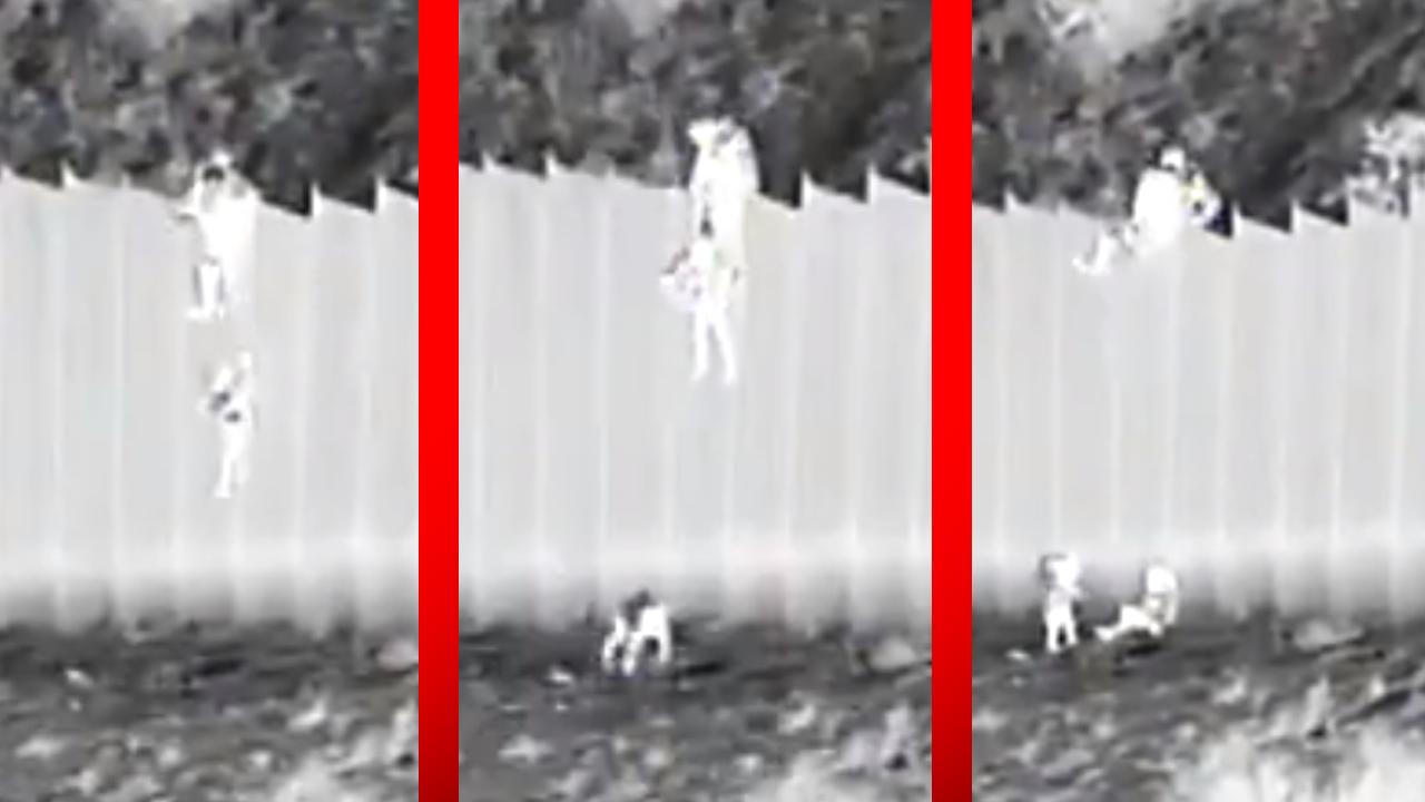 Arrojan a niñas desde lo alto del muro fronterizo